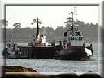 Départ d'une barge, avec ses remorqueurs, pour la Pologne