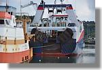 Gros plan sur le Jack Abry II de Lorient (LO 924831). Un habitué du port. Il est à quai avant son passage en câle sêche (prévue pour le lundi 16 août). On reconnait le concarnois Corail à ses côtés. Photo prise le 14 août 2010.