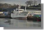 Le Malin à quai avec derrière lui le chantier de rénovation de la Calypso. Photo prise le 26 décembre 2010.